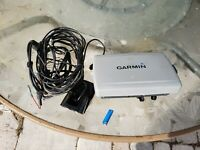 Garmin 720s chartplotter, fish finder combo with transducer and power cord.