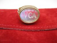 Van Cleef and Arpels 18 k y g heavy ring with moon stone and engraved logo