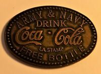 Two Coca Cola tokens: Army Navy and Betty Says