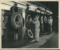 1951 Press Photo Armstrong Tire amp; Rubber employee scraping off rubber tips.