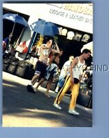FOUND COLOR PHOTO E0980 SHIRTLESS MAN WALKING BY LUGGAGE STORE