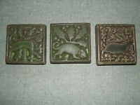 Green Motawi pottery tiles dog cat and elk in relief