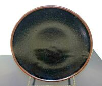 #sh18 VINTAGE BLACK  ART POTTERY PLATE, THICK GLAZE OVER PORCELAIN UNSIGNED 9