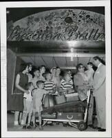 1957 Press Photo Children and Family with Luggage at the Sheraton Ballroom