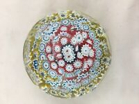 Vintage millefiori faceted dimpled glass paperweight with yellow rim