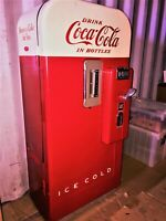 vintage coca cola machine color red and white in good condition and works
