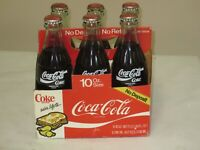 1980#x27;S COCA COLA 6 PACK BOTTLES NEVER OPENED DIFFERENT COUNTRY#x27;S ON BOTTLES