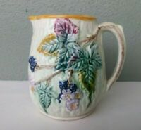 ANTIQUE MAJOLICA ART POTTERY PITCHER - EMBOSSED FLOWERS w/ PINK INTERIOR