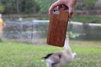Real wood cellphone case for iPhone amp; Samsung with wolf design engraved $20.00