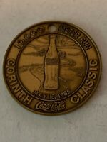 COCA-COLA 10,000 METER RUN, MAY 18,1985 CORINTH CLASSIC BRASS TOKEN w/HOLE,USED