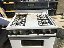 A Hotpoint Gas Stove white and black