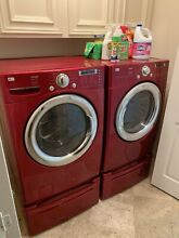 Used RED LG Tromm washer dryer with laundry pedestal