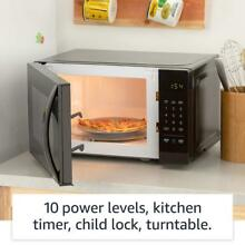 Small Basics Voice Controlled Microwave Oven In Compact Size Saves Counter Space