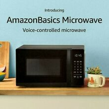 AmazonBasics Microwave  Small  0 7 Cu  Ft  700W  Works with Alexa oven stainless
