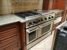GE Monogram  48  Dual Fuel Professional Range with 4 Burners  Grill  and Griddle