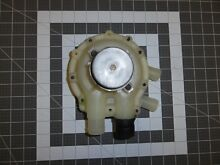WH23X42 Old Style GE 4 Port Washer Pump used on many models USED