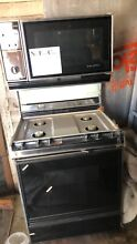Dual Gas Stove microwave   Never Used  Not Sure On Dimensions  Pick Up only