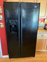 GE Profile Side by Side Refrigerator  Black    Used