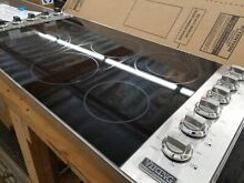 NEVER USED VIKING 36  ELECTRIC COOKTOP WITH STAINLESS STEEL TRIM AND KNOBS