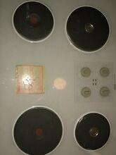 Jenn air white  cooktop 30 inch glass covered 4 porcelain burners excellent cond