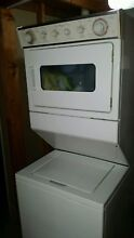 Used stacked Whirlpool washer and dryer