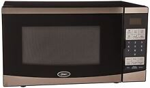 Oster 0 7 Cu  Ft  Compact Microwave   Stainless steel black Ogyu701