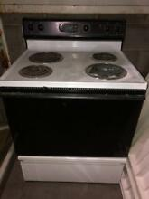Kenmore black white stove top oven