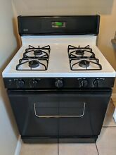 Used Kenmore good condition four burner gas stove black and white