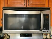 The Microwave and Hood combination in Stainless Steel