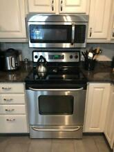 3 stainless steel appliances  stove  dishwasher and micro