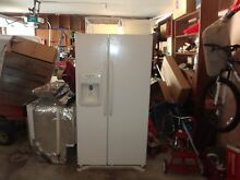 Maytag french door refridgerator off white with ice maker and water despenser