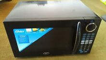 Oster Countertop Turntable Microwave Oven U11 Black 1000W 1 1 CuFt OGB81102