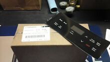 Frigidaire clock control module with black overlay part  5304508924