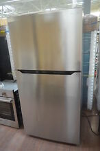 Insignia NSRTM21SS7 33  Stainless Top Freezer Refrigerator NOB  28367 CLW