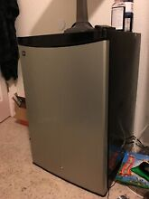 Mini fridge freezer used by GE  Has temperature settings inside  Very clean