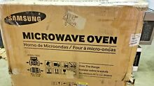 Dented    Samsung ME18H704SFS 1000W 1 8 cu  ft  Over the Range Microwave Oven