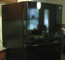 Refrigerator LG 20 Cubic Feet Top Freezer Black LTCS20220 30 inches Wide Used