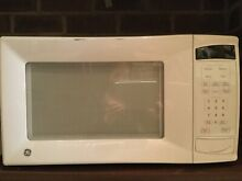 GE MICROWAVE  WHITE  GOOD CONDITION   LOCAL PICK UP ONLY FROM 60025