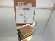 WH12X853  WASHER LID LOCK ASSEMBLY WASHING MACHINE