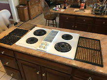 White Jenn Air Cooktop with grill and griddle accessories    Used