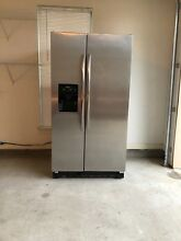 Amana Stainless Steel and Black Refrigerator