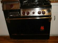 Used WOLF 29  GAS RANGE  4 BURNERS  RED KNOBS   HOOD MODEL A 4 9 HB11