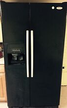 Whirlpool side by side refrigerator freezer