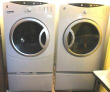 C  REDUCED TIL 5 1 18 GE FRONT LOAD MATCHING WASHER and DRYER  ON PEDESTALS
