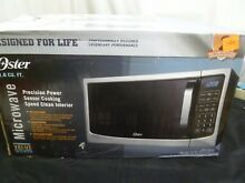 EXCELLENT COND Oster Design for Life 1 6 Cu ft 1100W Stainless Microwave TESTED