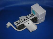 WR30X10012 electronic genuine GE OEM icemaker   makes 7 cubes   side fill cup
