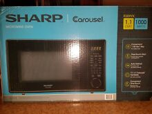 New Sharp Carousel R 309YK 1000W Microwave   1 1 cu ft  Unopened Box