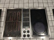 Jenn air downdraft cooktop with black glass burners and grill unit  lowest