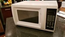 White countertop microwave oven lightly used