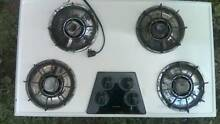 Four burner Kenmore gas stove top